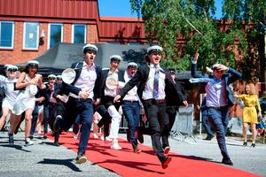Joy: Students run out of their school celebrating their high school graduation at Nacka Gymnasium in Stockholm, Sweden, yesterday after being subject to distance teaching since March. Photos: TT News Agency/AFP via Getty Images