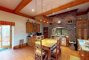 The kitchen/breakfast room with its Aga and the hermitage