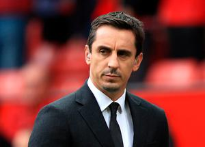 Gary Neville has questioned the motives behind football returning. Mike Egerton/PA Wire