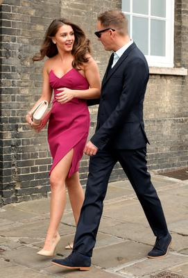 Brooke Vincent and Anthony Cotton, make their way to St Mary's Church in Bury St Edmunds, Suffolk, for the wedding of former Coronation Street actress Michelle Keegan to The Only Way Is Essex star Mark Wright. Yui Mok/PA Wire