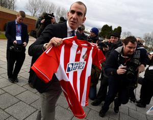 Sunderland's new coach Paolo Di Canio poses for photographs during a media conference at the football club's training academy in Sunderland