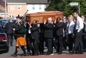 A piper walks in front as The coffin is carried to The Church of the Immaculate Heart of Mary, Rowlagh for the funeral mass of Keith Walker. Picture credit; Damien Eagers 19/6/2015