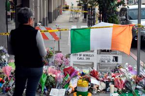 A woman views a memorial for those who lost their lives after a balcony gave way in Berkeley, California on June 17, 2015.  Dry rot and overcrowding could be responsible for the collapse of the balcony, sending six young Irish nationals plummeting to their deaths.     AFP PHOTO / JOSH EDELSONJosh Edelson/AFP/Getty Images