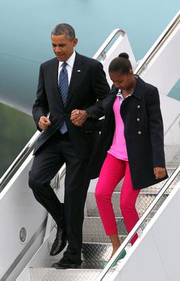US President Barack Obama exits Air Force One with his daughter Sasha upon arrival at Belfast International Airport, Northern Ireland, to attend the G8 summit in Enniskillen