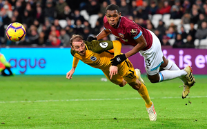 Brighton's Glenn Murray and West Ham 's Issa Diop. Photo: Getty Images