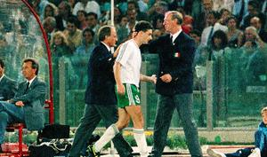 John Aldridge of Republic of Ireland is greeted by manager Jack Charlton on being substituted during the FIFA World Cup 1990 Quarter-Final match between Italy and Republic of Ireland at the Stadio Olimpico in Rome, Italy. Photo by Ray McManus/Sportsfile