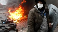 An anti-government protester mans a barricade in central Kiev. Reuters