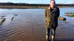 David Butler lost a significant proportion of his barley harvest because of saturated fields. Image: Belfast Telegraph