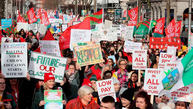 Childcare workers take part in a protest in Dublin's city centre over low wages and to highlight the childcare crisis. Photo: Brian Lawless/PA Wire
