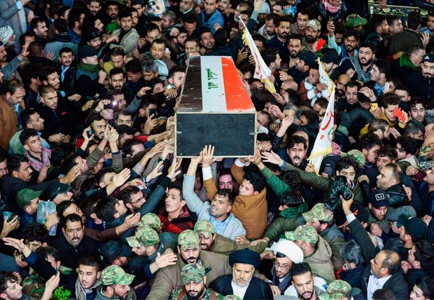 Mourners in the Iraqi city of Najaf carry the coffin of paramilitary chief Abu Mahdi al-Muhandis, who died alongside Qasem Soleimani in Baghdad. Picture: AFP via Getty