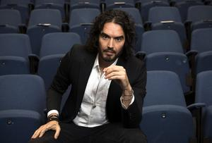 Russell Brand poses for photographs as he arrives to deliver The Reading Agency Lecture at The Institute of Education in London. Russell Brand will deliver 'a manifesto on reading' which will be in part personal, sharing his own experience of books and reading while growing up in the UK. Carl Court/Getty Images