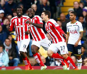 Stoke City's Bojan Krkic celebrates his goal against Tottenham Hotspur with Mame Diouf and Victor Moses