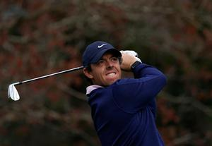 Rory McIlroy watches his tee shot on the third hole during the third round of the Zozo Championship PGA Tour at the Accordia Golf Narashino country club