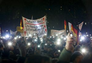 "Participants use lights on their portable phones as they take part in a demonstration called by anti-immigration group PEGIDA, a German abbreviation for ""Patriotic Europeans against the Islamization of the West"", in Dresden January 5, 2015. REUTERS/Fabrizio Bensch"