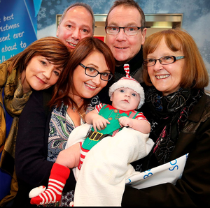 Emily Mc Cullough and 10-week-old Sonny and husband Johnny (not pictured) are welcomed home from Perth by parents and grandparents Angela and Martin Murphy and Cathy and William Mc Cullough Photo: Steve Humphreys