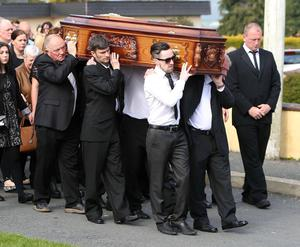 David Shortall, wearing sunglasses, helps to carry the coffin at the funeral of his mother, Anne Shortall at St Josephs Church in Rathnew. Picture credit; Damien Eagers