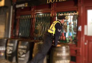 Garda Sergeant Damian Fitzpatrick pictured in April checking a pub in Dublin City centre was safe and secure during the Covid-19 lockdown Pic: Mark Condren