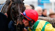 Robbie Power kisses Sizing John after their Timico Cheltenham Gold Cup win