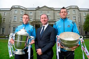 Dublin football boss Jim Gavin with Denis Bastick, right, and hurler Johnny McCaffrey, left, at the launch of the Leinster Senior Championships in Farmleigh House