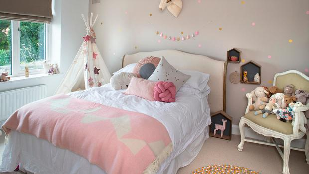Chloe's pretty bedroom has pink accents with lots of touches, such as the wall decals and animal head from Little Lamb, the section of Emma's website which caters for children. The chair is vintage