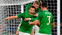 Ireland striker James Collins, centre, is congratulated by team-mates James McClean, behind, and Enda Stevens, after scoring his side's third goal during friendly match between Republic of Ireland and Bulgaria at Aviva Stadium, Dublin. Photo: Seb Daly/Sportsfile