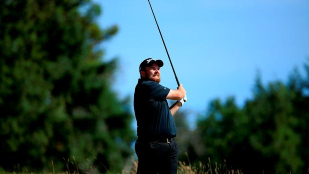 UNIVERSITY PLACE, WA - JUNE 20:  Shane Lowry of Ireland hits his tee shot on the 14th hole during the third round of the 115th U.S. Open Championship at Chambers Bay on June 20, 2015 in University Place, Washington.  (Photo by David Cannon/Getty Images)