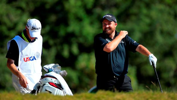 UNIVERSITY PLACE, WA - JUNE 20: Shane Lowry of Ireland waits with his caddie Dermot Byrne on the 14th hole during the third round of the 115th U.S. Open Championship at Chambers Bay on June 20, 2015 in University Place, Washington.  (Photo by David Cannon/Getty Images)
