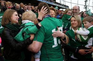 Ireland's Brian O'Driscoll is embraced by his mother Geraldine along with his wife Amy Huberman (left) holding their daughter Sadie after his final home international at the RBS Six Nations match at the Aviva Stadium