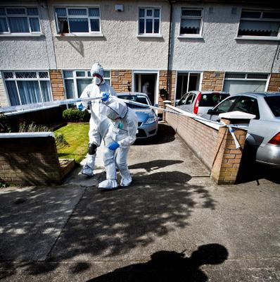 Forensics officers at the home of Violet Quigley