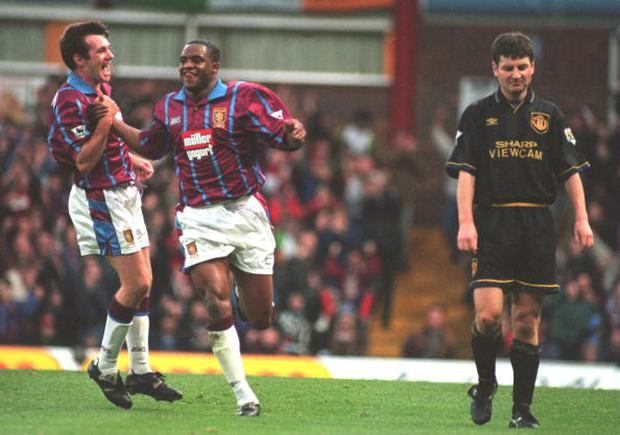 RAY HOUGHTON AND DALIAN ATKINSON OF ASTON VILLA CELEBRATE ATKINSONS GOAL AGAINST MANCHESTER UNITED DURING THE ENGLISH PREMIER LEAGUE MATCH AT VILLA PARK, BIRMINGHAM. AT RIGHT, DENNIS IRWIN OF MANCHESTER UNITED. Mandatory Credit: David Rogers/ALLSPORT