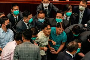 Scuffle: Eddie Chu was among the legislators removed from the chamber. Photo: Anthony Kwan/Getty Images