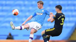 Manchester City's Kevin De Bruyne in action with Arsenal's Kieran Tierney as the Premier League resumes behind closed doors. Photo: Laurence Griffiths/Pool via REUTERS