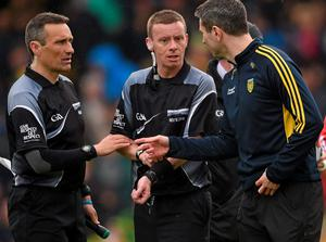 Maurice Deegan (left) – here chatting to referee Joe McQuillan and Donegal boss Rory Gallagher last Sunday – says sledging is hard for officials to police
