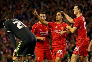 Liverpool forward Suso celebrates after putting his side ahead in extra-time of their Capital One Cup clash with Middlesbrough at Anfield. Photo: REUTERS/Andrew Yates