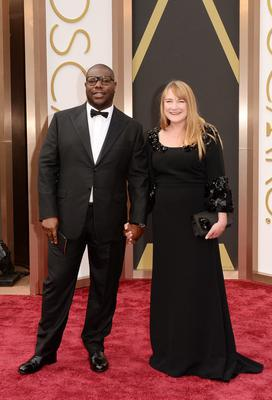 Director Steve McQueen and producer Bianca Stigter attend the Oscars held at Hollywood & Highland Center on March 2, 2014 in Hollywood, California.  (Photo by Jason Merritt/Getty Images)