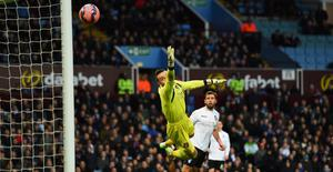 Lee Camp of Bournemouth fails to stop the shot of Villa's Carles Gil