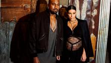 Musician Kanye West stands with his wife Kim Kardashian after watching the Givenchy Spring/Summer 2016 collection during New York Fashion Week