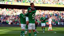 Callum Robinson of the Republic of Ireland celebrates with team mate David McGoldrick after a Gibraltar own goal during the 2020 UEFA European Championships group D qualifying match between the Republic of Ireland and Gibraltar at the Aviva Stadium on June 10, 2019 in Dublin, Ireland. (Photo by Mike Hewitt/Getty Images)