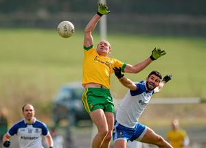 Donegal's Neil Gallagher and Monaghan's Neil McAdam challenge for the ball