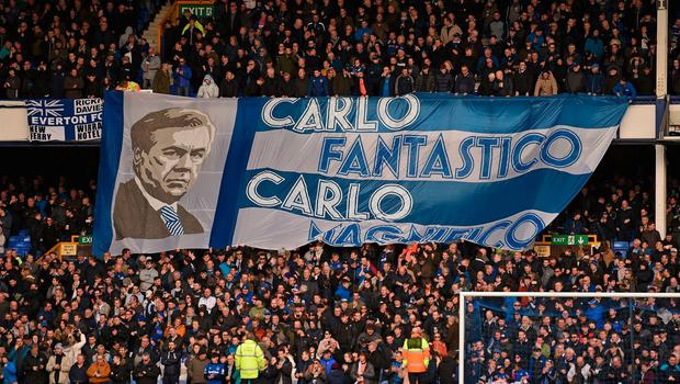 Toffees fans unveil a banner to honour their new manager. Photo: Oli Scarff/AFP via Getty Images
