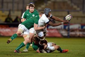 Maro Itoje of England tackled by Peter Robb and Dan Leavy of Ireland