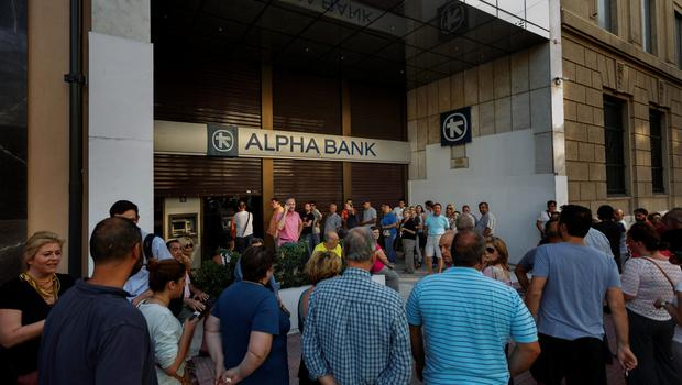 Queues formed beside ATMs all over Greece yesterday as customers desperately tried to withdraw cash from their accounts.