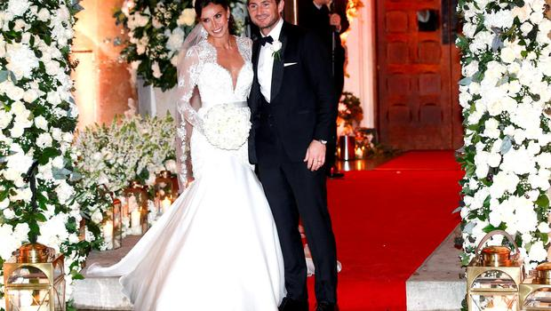 British TV personality Christine Bleakley and former Chelsea and England soccer player Frank Lampard leave church after they married in London, Britain, December 20, 2015