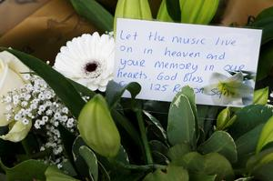 A message on a floral tribute at the Clutha pub in Glasgow, Scotland, as a service is held in at Glasgow Cathedral marking the first anniversary of the helicopter crash that caused that caused the death of ten people. Photo: Danny Lawson/PA