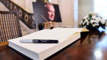 A portrait and a book of condolences for Martin McGuinness who died yesterday is seen in Stormont's Parliament buildings, in Belfast, Northern Ireland. REUTERS/Clodagh Kilcoyne