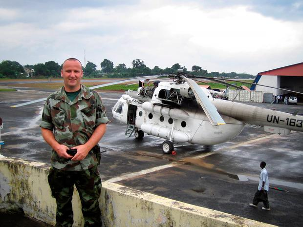 Nightmares: Former soldier Paul O'Reilly during a mission to Liberia in 2004