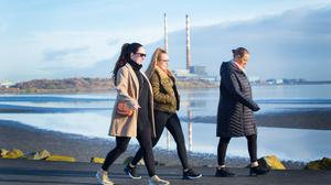 Calm before the storm: Walkers enjoy a crisp morning ahead of the arrival of Storm Ciara this weekend. Photo: Owen Breslin