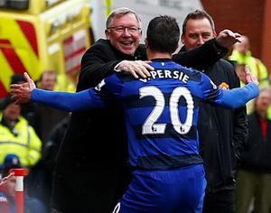 Manchester United's Robin van Persie celebrates after scoring a penalty with manager Alex Ferguson. Photo: Reuters