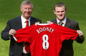 Alex Ferguson with his new signing Wayne Rooney in 2004