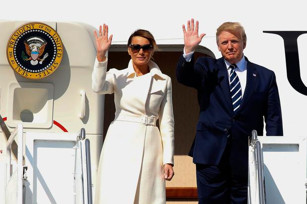 US President Donald Trump (R) and First Lady Melania Trump (L) wave as they disembark Air Force One upon arrival at Shannon Airport in Shannon, County Clare, Ireland on June 5, 2019